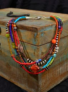 Multi colour bead necklace with five portions and a bigger accent bead to separate them. African Jewelry, Tribal Jewelry, Wire Jewelry, Boho Jewelry, Jewelry Crafts, Jewelry Art, Beaded Jewelry, Jewelery, Jewelry Necklaces