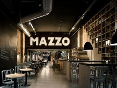 classic lit sign at Mazzo restaurant - by Concrete Architectural Associates