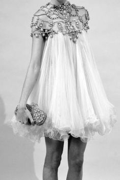 Put a belt on it and that would be considered a stunning modern gown