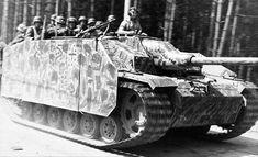 A Stug 4 with scherzen giving quite a few soldiers a welcome lift.