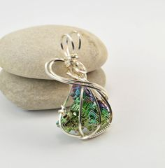 Green bismuth crystal wire wrap pendant  by FeathersnThingz