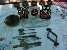 """GARDEN YARD ART ITEMS!  WINDCHIMES, TRIVETS AND MORE!  ALL USED!  A LOT OF 7 ITEMS!  INCLUDES:  1-CANDLE HOLDER   1-BUTTERFLY TRIVET (QUITE RUSTY)  1-TILE: """"NO SMOKING"""" IN SEVERAL LANGUAGES  1-TEA POT TRIVET (QUITE RUSTY)  1-5-PLACE TEA CANDLE HOLDER  1-A MARBLE (OR PERHAPS, MARBLE, AS WE ARE NOT SURE) CENTER PIECE  1-WINDCHIMES MADE FROM UNUSED FLATWARE (IT IS QUITE MUSICAL!)"""