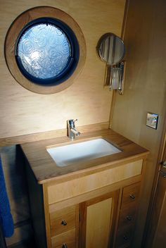 Sink unit with storage by Beacon Boats LTD
