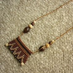 A truly unique, OOAK piece of wearable fiber art .        This necklace presents a very fine work of micro macrame , uniquely designed in a