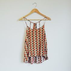 Geometric pleated shirt Colors: Orange, navy, mint, red. Size: One Size but fits more like a Medium Ivory Surf Tops