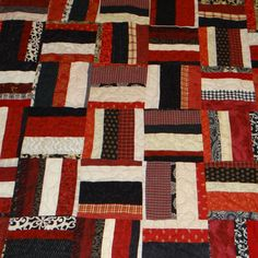 Red, black, grey and tan queen size quilt after christmas sale. $199.00, via Etsy.