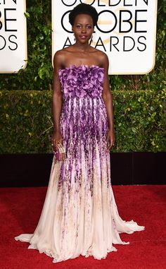 Lupita Nyong'o is a red carpet highlight (per usual) in this Giambattista Valli Couture beauty. That purple is perfection on her!
