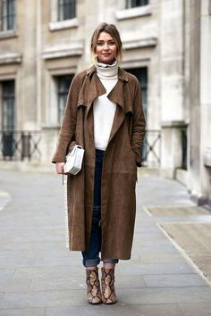 Stockholm Street Style Will definitely be taking pointers from this street style star's cozy cool ensemble. Her suede trench coat and python ankle boots are a perfect match for winter.