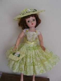 Cissy all dressed in yellow for spring. Dress by DollDreamsByNatalie, hat & bag by Richard.