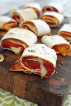 Umm...yum! Easy tortilla pizza rolls - any sauce, any cheese, roll em up and bake for about 7 min in oven. BAM!