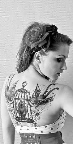 Heart in birdcage with Swallows tattoo