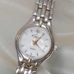 This #vintage mother of pearl shell ladies watch is absolutely wonderful!  It features a silver tone case with a round mother of pearl face, accented with gold hashmarks and... #ecochic #etsy #jewelry #jewellery