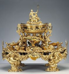 Now this is a centerpiece! The Neptune Centrepiece, 1741/2. Described as 'the purest rococo creation in English silver, it forms part of the superb Marine Service of rococo plate which was almost certainly supplied for Frederick, Prince of Wales, in the early 1740s. The highly fashionable design shows a strong continental influence and reflects the sophisticated tastes and inspired patronage of the Prince, who played a significant role in introducing the rococo style into England.