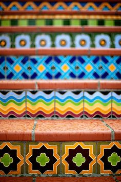Mosaic stairs - These are great patterns and colors. Would be fun to do them in cement tile as well.