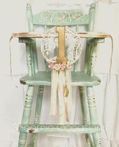 A shabby chic vintage highchair painted in a perfect vintage mint. A Shoomie Occasions original, dream catcher high chair banner is included with rental. Our highchairs are perfect…