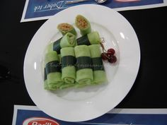 Dadar Gulung is one of popular snacks in Indonesia, especially in Java. Dadar literally means 'pancake' while gulung means 'to roll'. Inside has sweet grated coconut as a filling, and usually is green-coloured which comes from Pandan leaves. . It is very aromatic and has a unique taste that can be used for many Indonesian desserts, cakes and drinks.