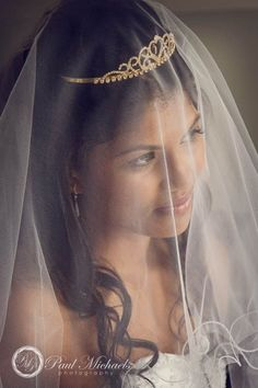 Bride looking through her veil while getting ready.  #Wedding #photographers, #Wellington, New Zealand. http://www.paulmichaels.co.nz/