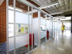 Glass office partitions from the Sliding Door Company. Comes in a variety of finishes such as laminated, frosted, clear, linen, or a combination.