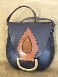 Hey, I found this really awesome Etsy listing at https://www.etsy.com/listing/207759528/vintage-black-leather-hand-tooled