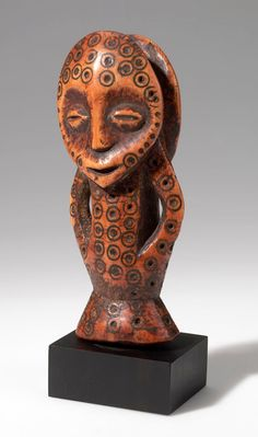 Africa | Figure from the Lega people of DR Congo | Ivory and pigment | 20th century