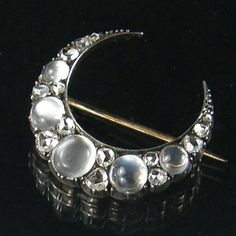 Moonstones in a moon brooch. Victorian.