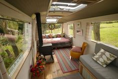 interior design ideas for vintage campers - This would be cute for a big, old, clunker camper that would just be parked. With the skylights & woodstove this would make a GREAT art studio!!