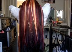 Dark hair with red & blonde streaks.