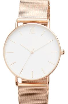 A grooved bezel and raised hour marks add minimalist touches to this versatile wristwatch secured with a gleaming chain-mesh bracelet. / @nordstrom #nordstrom