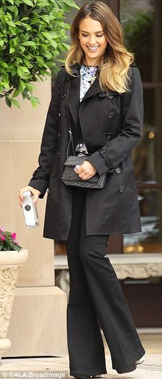 Always on point: Alba rarely puts a foot wrong and this stylish outfit combated the drizzle without sacrificing taste
