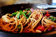Ingredients 8 ounces, weight Bucatini Or Spaghetti 2 Tablespoons Olive Oil 1/2 whole Red Onion, Sliced 1-1/2 cup Grape Tomatoes, Halved 3/4 cups Chicken Broth Or White Wine 2 cloves Garlic 4 whole Anchovy Filets 1/2 cup (heaping) Assorted Pitted Olives 12 whole Basil Leaves 4 ounces, weight Good Parmesan Cheese