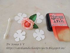 Easy Paper rose tutorial - use diecut , punched or hand cut flowers. I used Spellbinders rose creations die