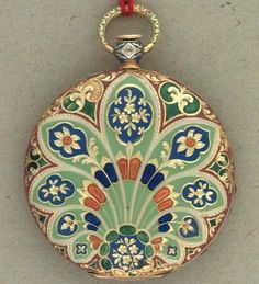 """Pocket Watch done in Champlevé or """"engraving enameling"""", a very ancient technique that evolved over time. The name comes from the French for """"raised field"""". It can be split in 2 distinct techniques: Champlevé on Bronze Fusion & Champlevé on Copper Plate"""
