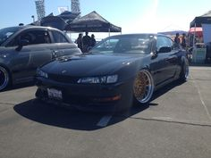 1998 240sx slammed with extreme wheels.  With an ls swap and procharger, this thing would be awesome.