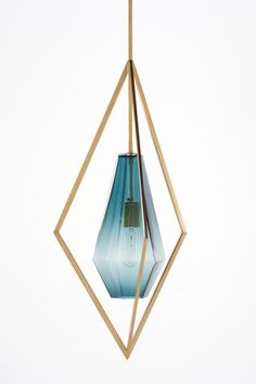 Unifying aesthetics and practicality, the Tetra collection is a unique and stylish lighting fixture like no other. Each hanging fixture is composed of an outside framework and a gem-like glass interio…