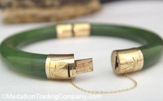 Antique 14k 9mm Nephrite Jade Bangle Etched Chased Hinged Bracelet Safety Chain --- $499.95 MedallionTradingCompany.com  Clasp and hinge work. No chips or cracks are present in the jade.  Markings:  14k   Bracelet measurements: Approximately 2.25 inches   (round) in diameter on the INSIDE of the bracelet, approximately 9mm  thick (will fit the average sized wrist- medium to medium/large)  Push clasp has a safety chain (see pictures)  Weight: 40.6 grams   Metal: Solid 14k yellow gold, stamped