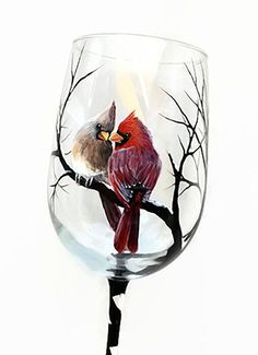 Cardinal Snowy Tree Branches Hand Painted Wine Glass Winter Scene Holiday Christmas Stemware Unique Artistic Nature Lover Gift Red Bird Art  Snuggle up next to the fire and warm up your winter with these seasonal Winter Wine Glasses! Snow capped branches swirl around as you sip while a little bird friend accompanies you. These glasses make incredibly unique gifts for housewarmings, birthdays, weddings and more as they are all one of a kind original pieces of usable artwork. The glass shown…