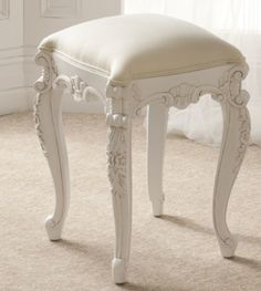 I liked this chair to be used for the table because it has both the colour themes white and cream on it and its cushioned so it would be comfy to sit on while doing your make-up or working.