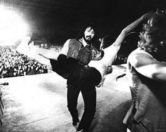 Keith Moon being carried off stage by John Entwistle.