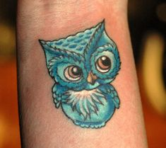 Blue Ink Small Owl Tattoo Design For Wrist