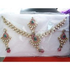 Upto 50% off Eshaa jewellery - Magenta and pearl bridal set