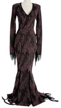 Costume designed by Ruth Meyers for Anjelica Huston in The Addams Family, she looked like this was painted on and worn like it was her second skin...great design