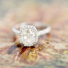 Cushion brilliant diamond | Double prong claw tiered halo pave platinum setting | Photo by www.josevilla.com
