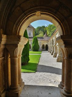 Archway from inside the cloisterie looking into the courtyard of the church at Fontenay Abbey, Burgundy region, France.