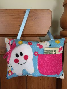 A personal favorite from my Etsy shop https://www.etsy.com/listing/260186485/hello-kitty-tooth-fairy-pillow