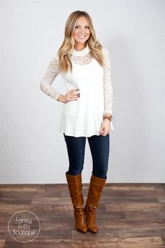 We are in LOVE with our new fabulous lace cowl neck tunic for all your upcoming holiday occasions! We love the lace detail on the sleeves and neck, to give this blouse a pop that is sure to have you turning heads! The tunic length is great for leggings, jeans, or dressed up with your favorite pencil skirt! This is sure to be your favorite new go-to blouse!Sizing:Small 0-4Medium 4-8Large 8-12Model is wearing a size small. Fits true to size.