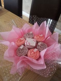 Cupcake Bouquet Discover Cupcake Bouquets Cupcake Bouquets are made up of 7 14 or 19 cupcakes with a rose buttercream swirl on top hand tied with cellophane tissue paper and co-ordinating ribbon. Bouquets can be made in a variety of. Cupcake Flower Bouquets, Food Bouquet, Flower Cupcakes, Diy Bouquet, Mothers Day Cupcakes, Mothers Day Cake, Cupcake Gift, Cupcake Cookies, Garden Party Cakes
