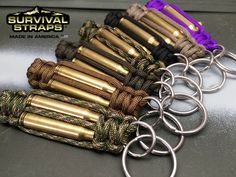 """NEW PRODUCT! .223 Caliber Key Fob! The new .223 Caliber Range Master Bullet Key Fob combines classic Survival Straps® paracord with actual spent, recycled, tumbled & polished brass bullet shell casings. Available in a wide range of colors, this key fob is perfect for anyone who loves America, weaponry and the shooting sports. Great for both men and women! Built with a small ring embedded in one end. A 1"""" key ring is included and attached. This allows the key fob to sit flat while in a…"""