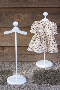 American Girl Doll Dress Stand by TheWoodenWorkshop on Etsy. Sells for $9.00. Dimensions: 6 x 6.5 x 19 inches. Looks like a great way to display a collection behind glass...