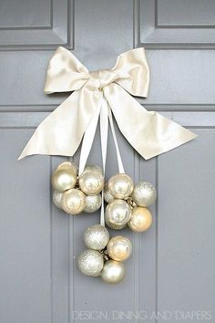I whipped up this quick DIY Ornament Door Decoration using ornaments and ribbon from the dollar store and some fishing line and extra ribbon I had laying around.