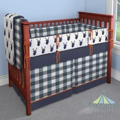 Crib bedding in Solid Navy, Navy Buffalo Check, Windsor Navy Deer Head, Solid Rustic Orange. Created using the Nursery Designer® by Carousel Designs where you mix and match from hundreds of fabrics to create your own unique baby bedding. #carouseldesigns